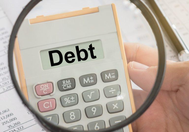 Debt being shown on a calculator