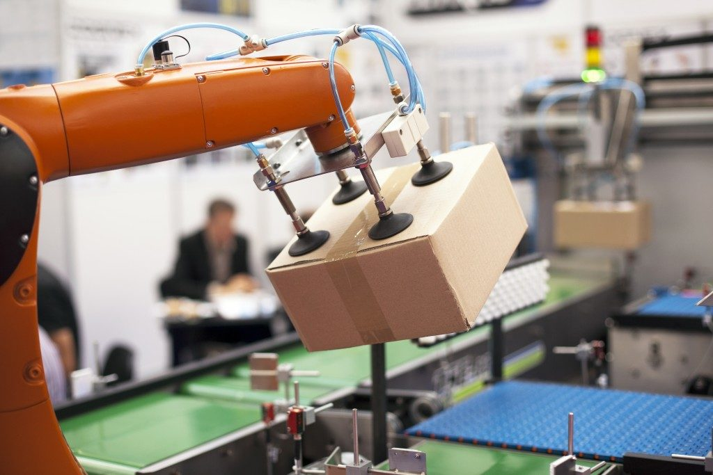 Robotic arm holding a box package