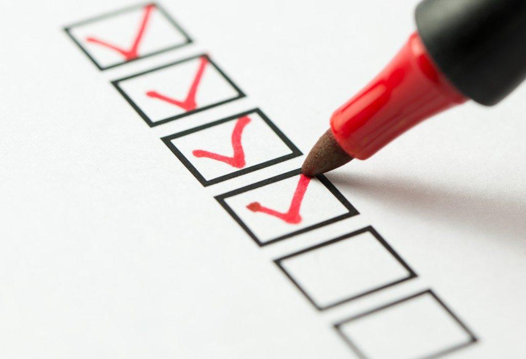 checklist wth red marker