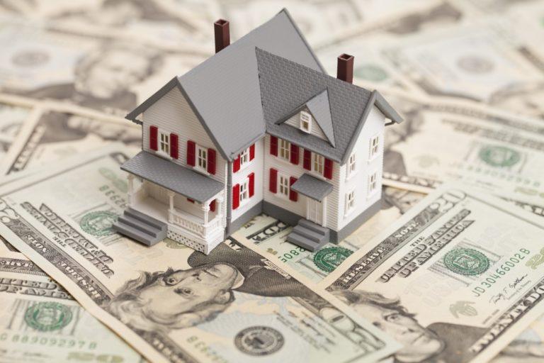 model house on a money background