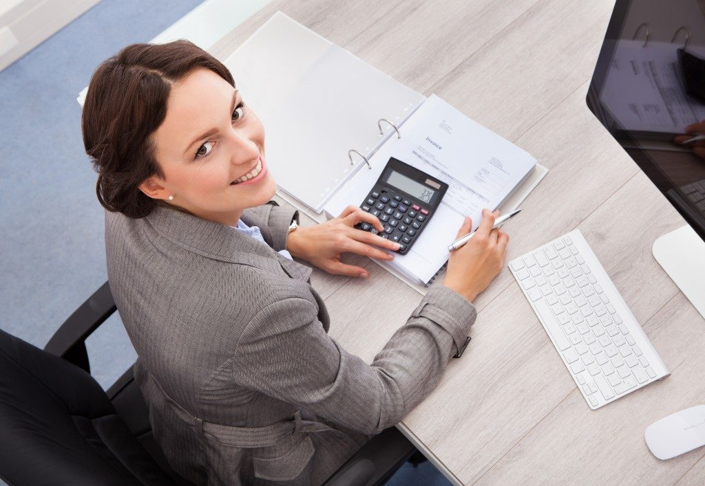 Female accountant calculating bills