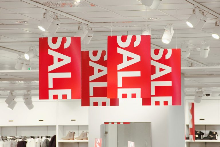 sale sign on the mall ceiling