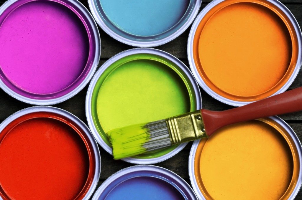 different colored paint cans