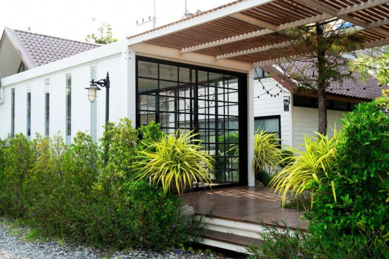 beautiful container home with porch