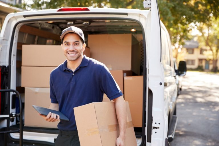 man on his way top deliver a parcel