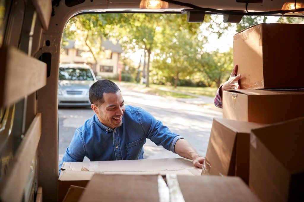 man moving boxes from the van