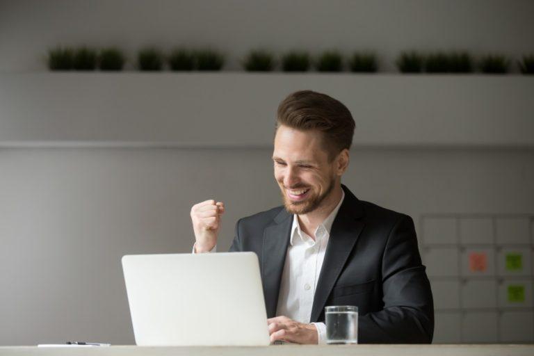 man happy about work accomplishment