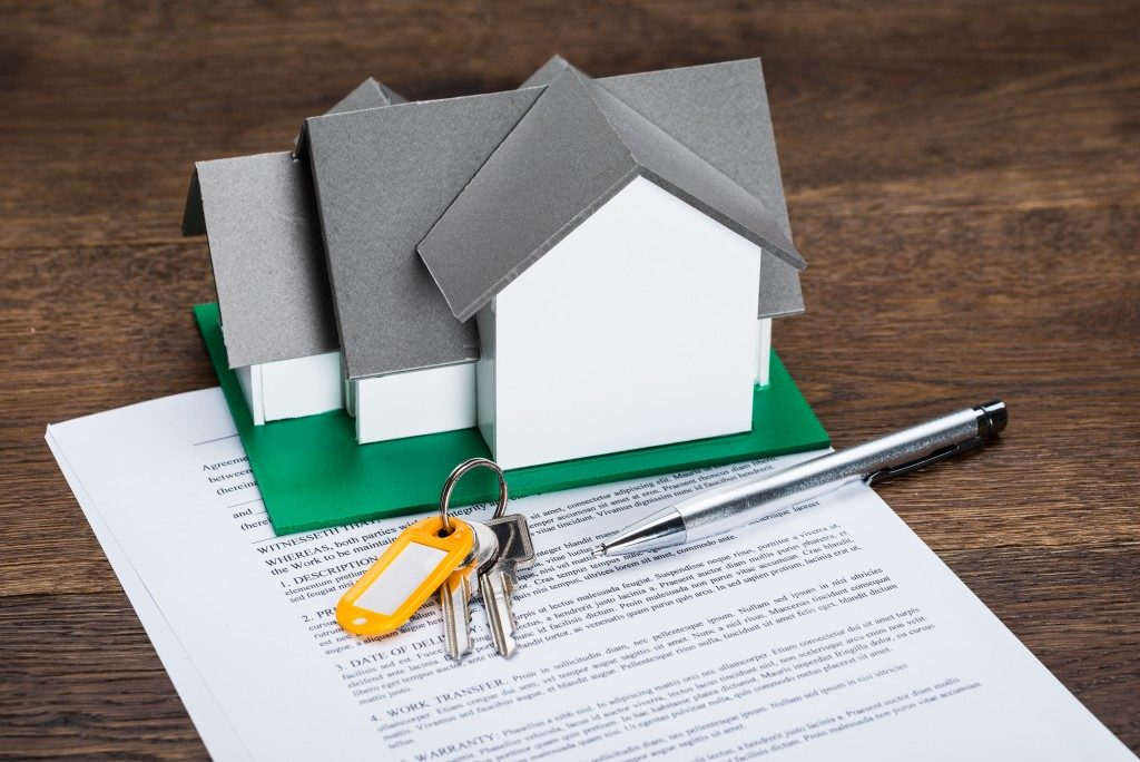 House Model With Keys And Ballpen On Contract Paper