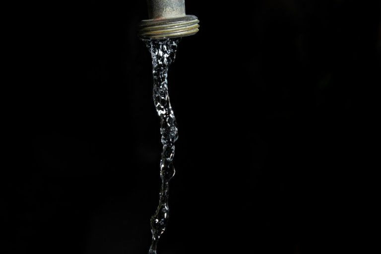 Running water from faucet