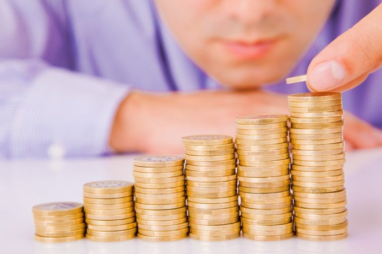 Business man rising coins
