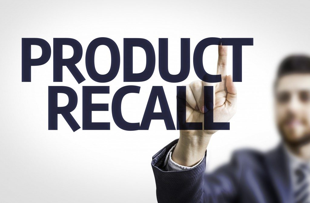 man pointing towards product recall