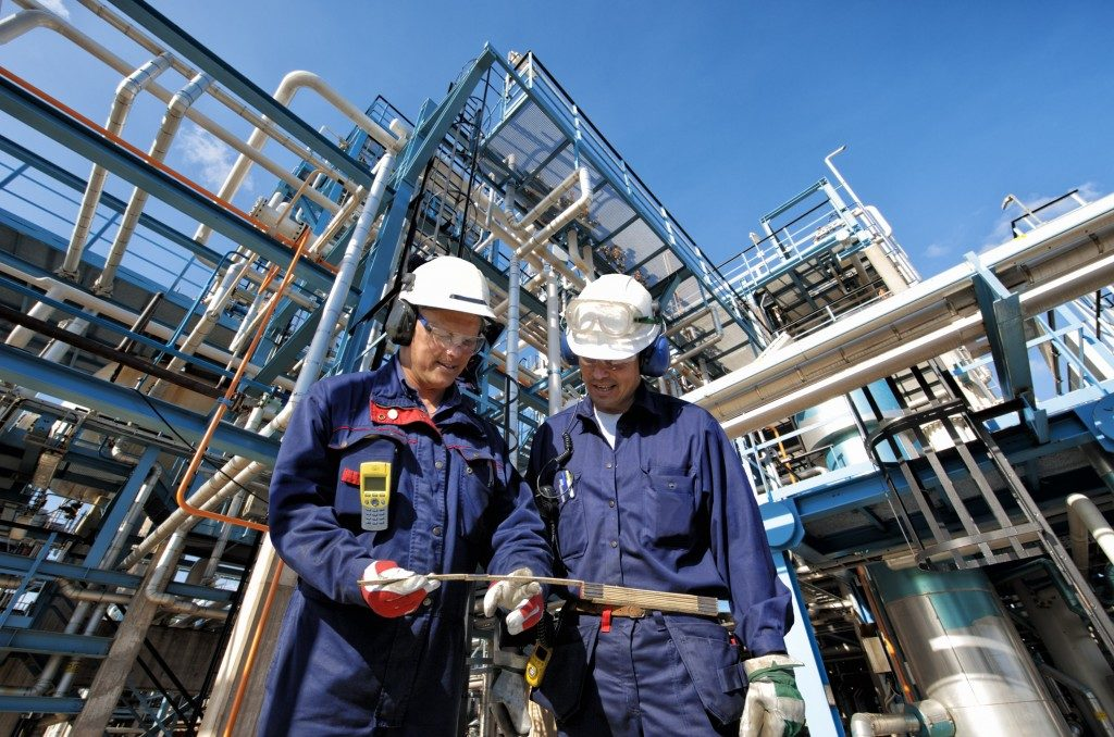 Two workers in oil refinery