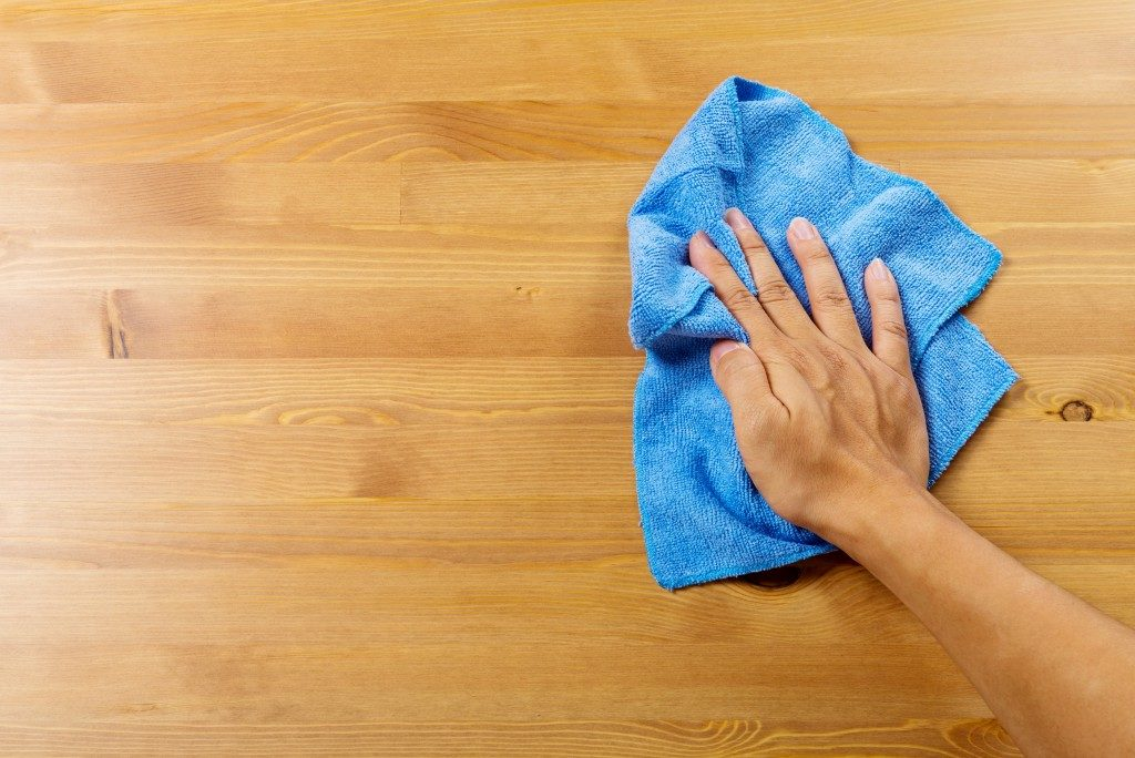 cleaning the wood flooring