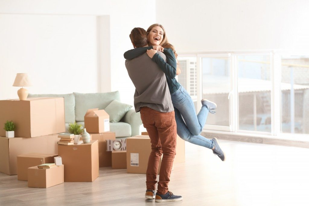 couple hugging each other, moving to new home