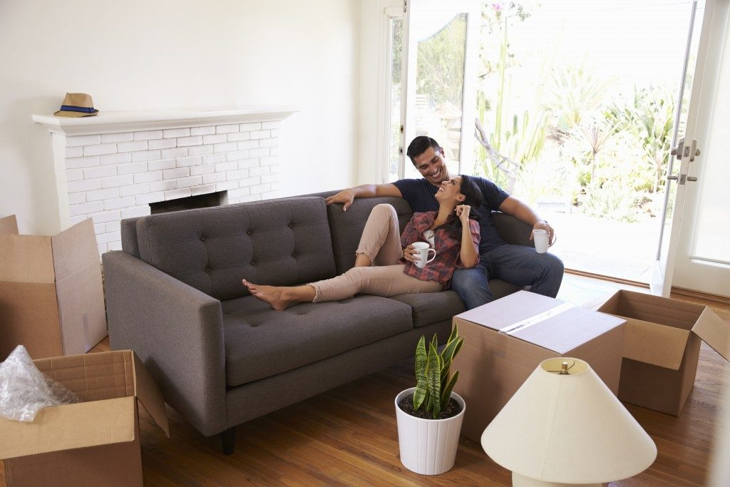 Couple on the couch after moving into new home