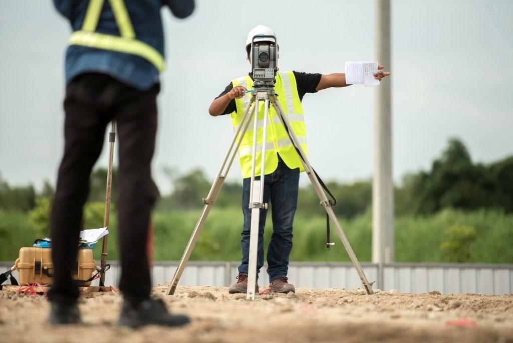 men land surveying