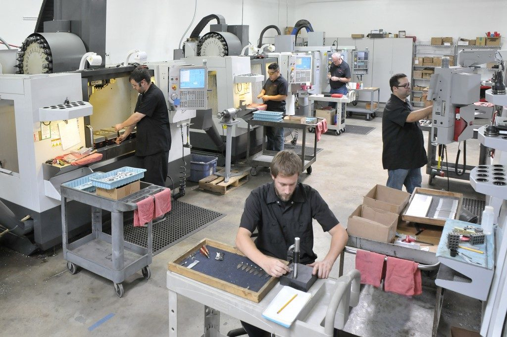 technicians and workers at a factory