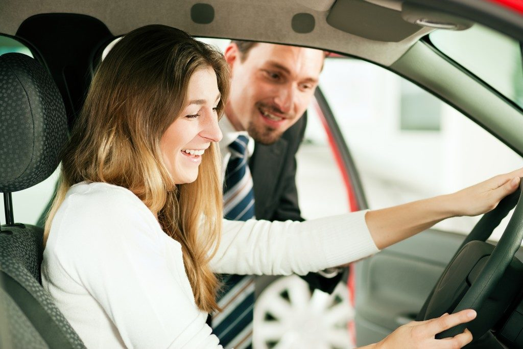 woman checking out a car