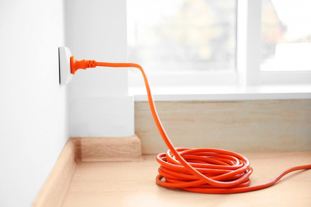 orange plug in an electrical outlet