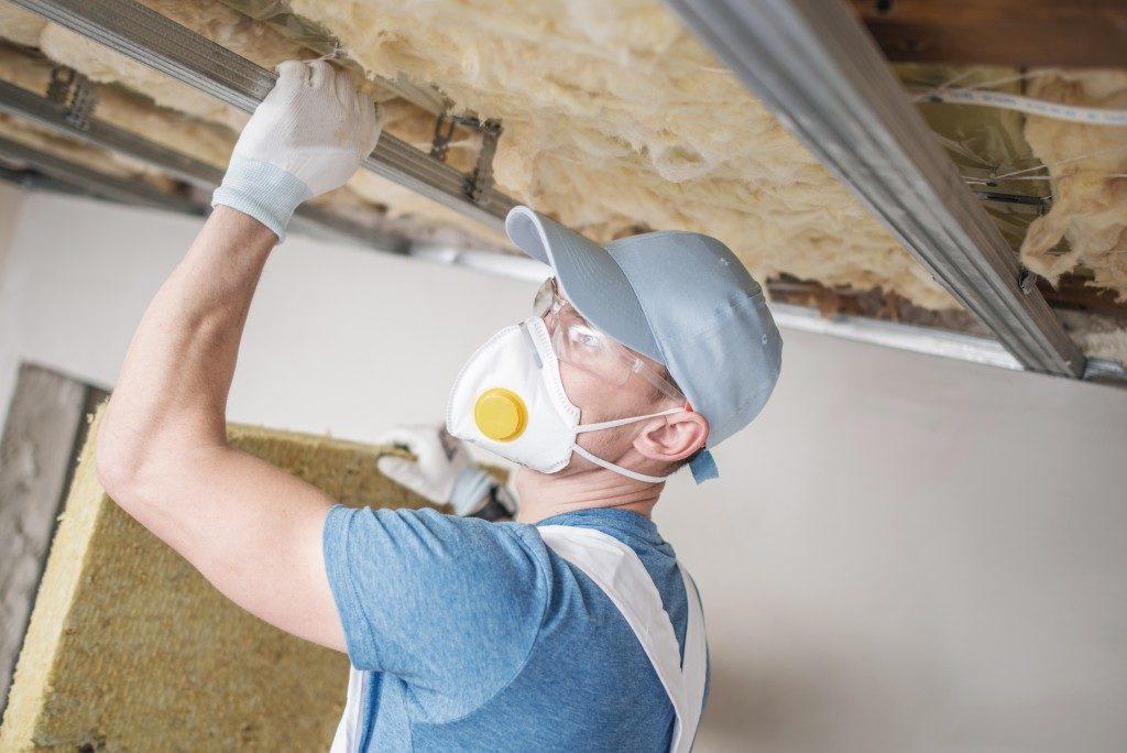 Worker installing insulation