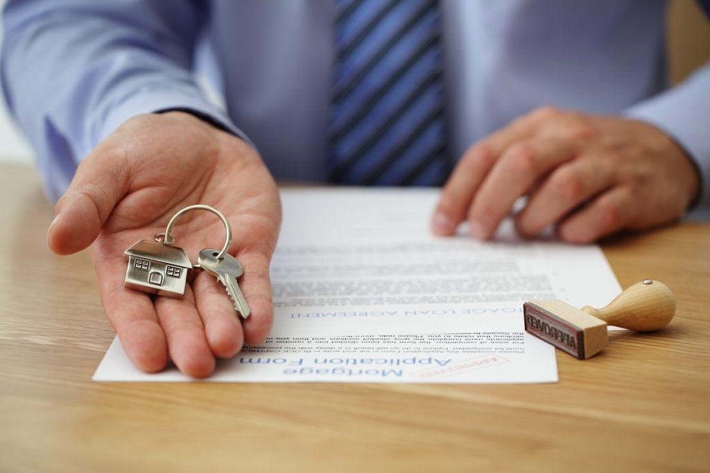 man giving house keys