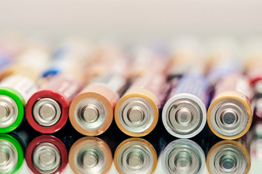 Closeup of pile of used alkaline batteries.