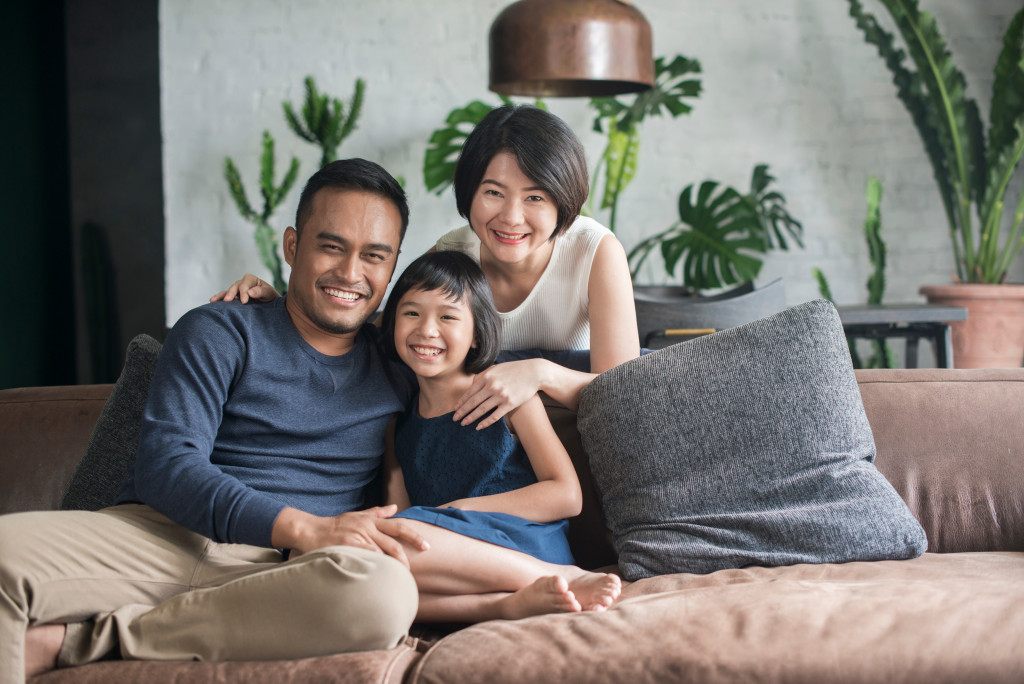 Asian family sitting in the living room