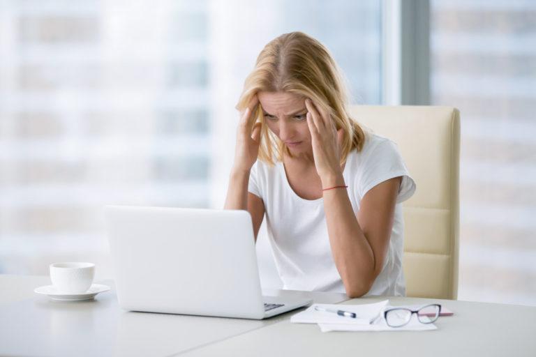 woman having a headache in work