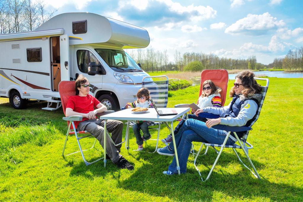 family outside camper