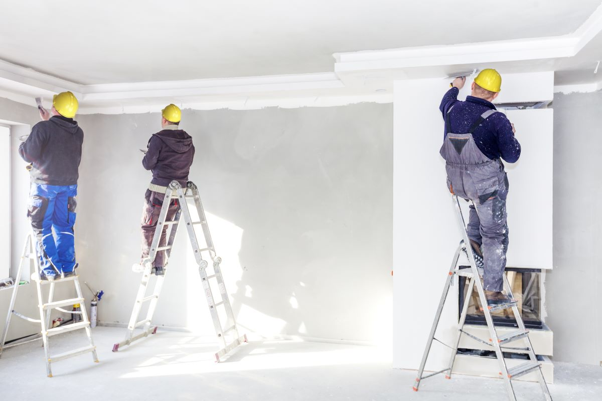 workers painting room