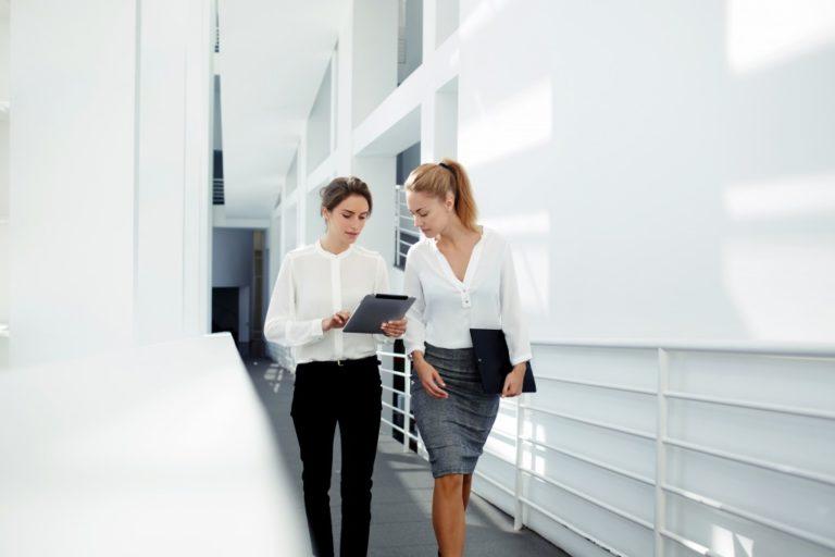 two employees walking