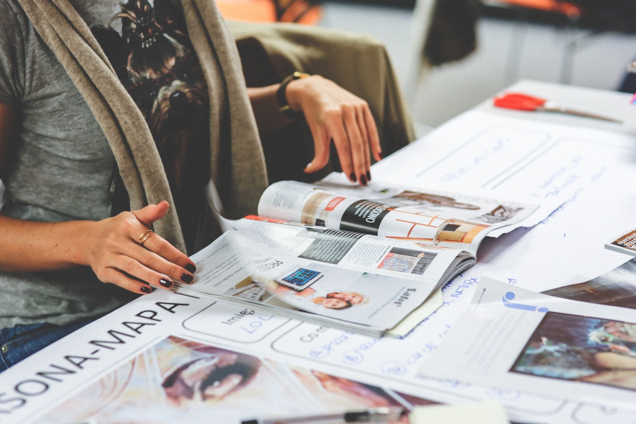 employee checking the printed magazine