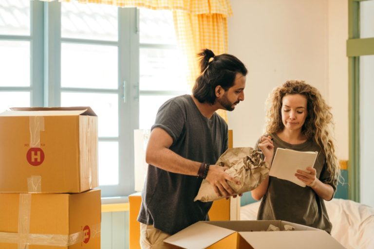 couple checking items while unpacking