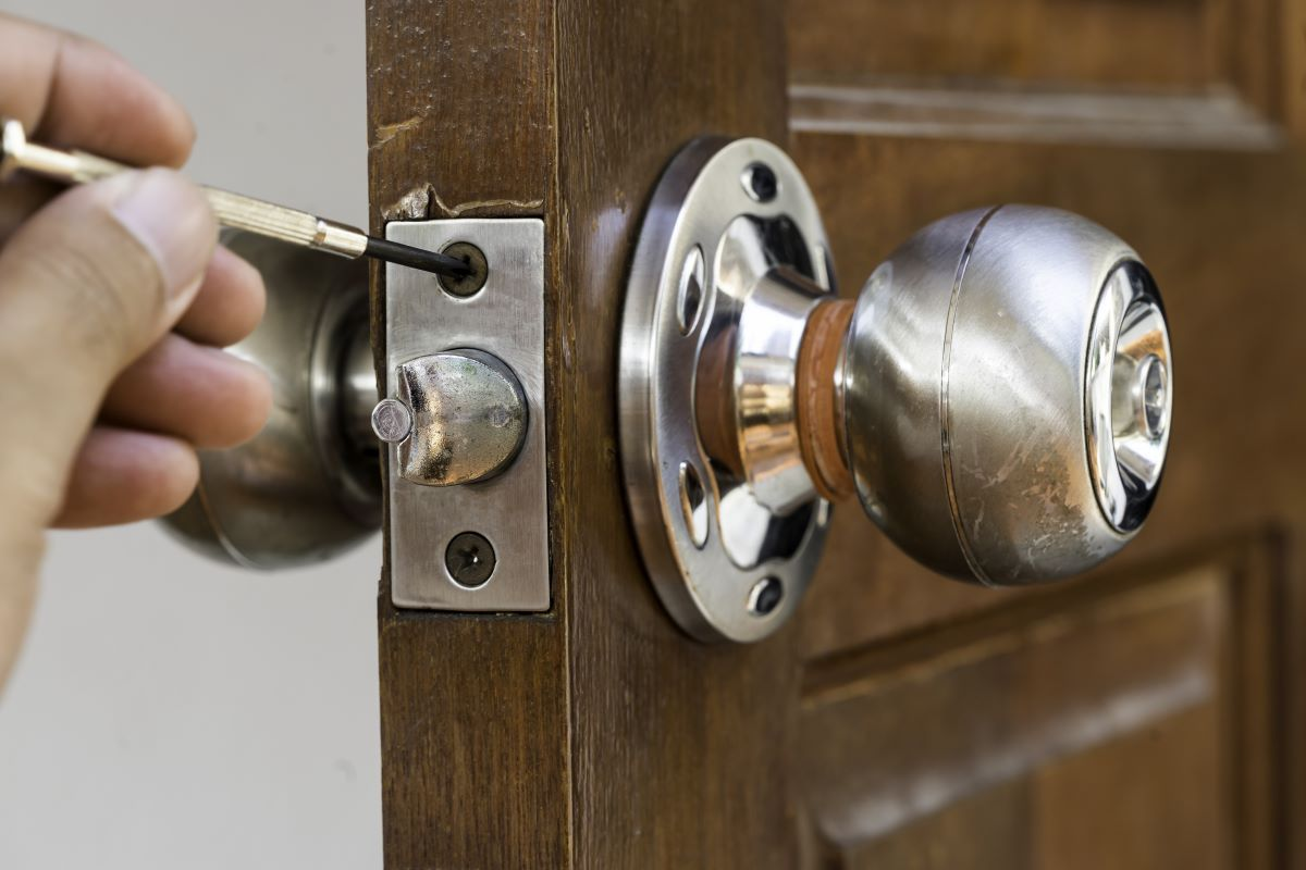 locksmith working on door lock