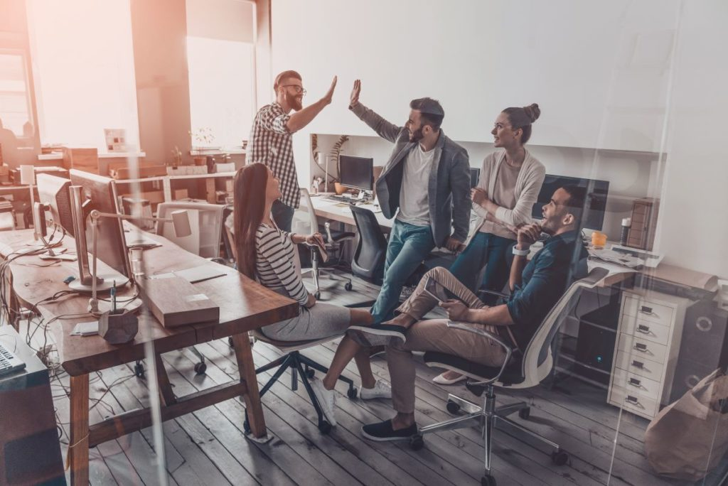 group of people cheering in an office