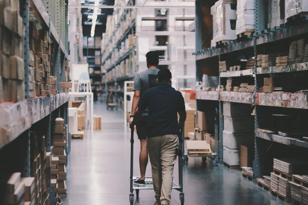 2 people inside a storage warehouse