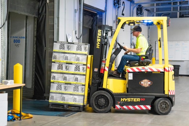 man operating a forklift