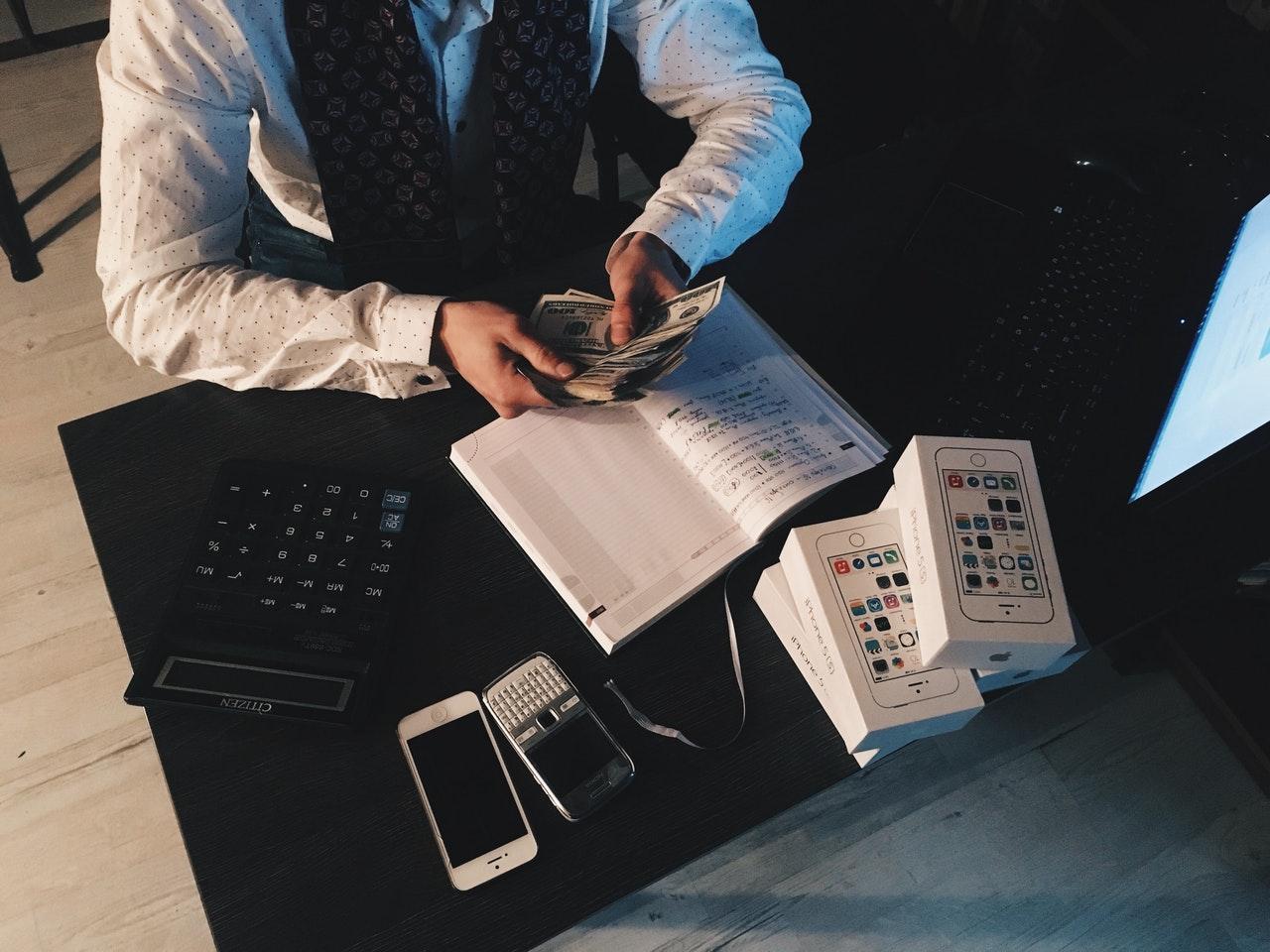 businessman computing finances