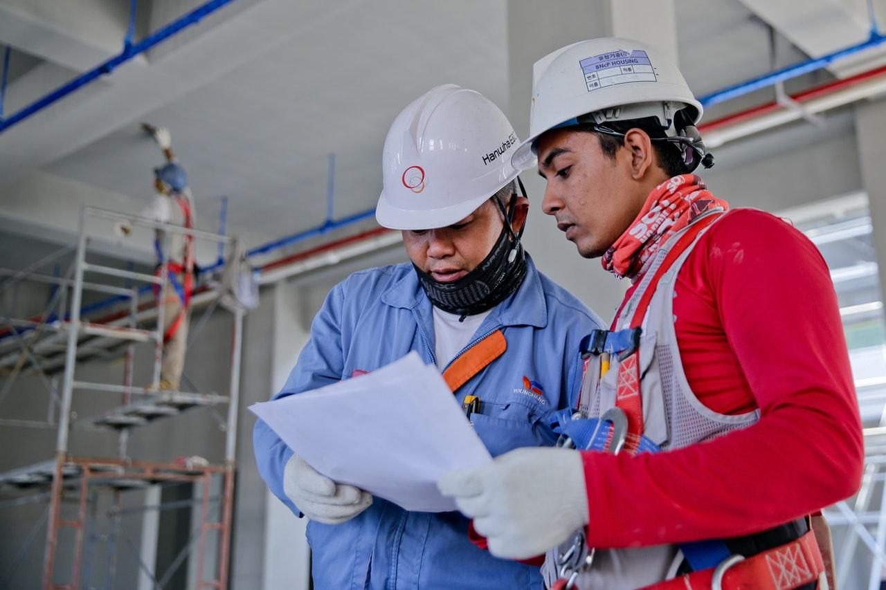 men discussing the blueprints