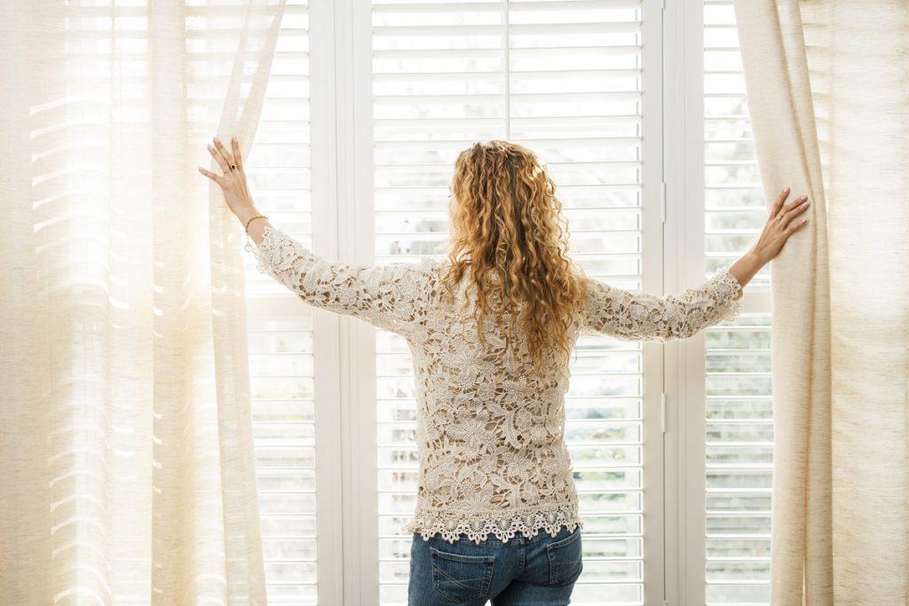 woman looking outside