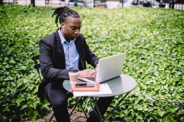 man using his laptop outdoors