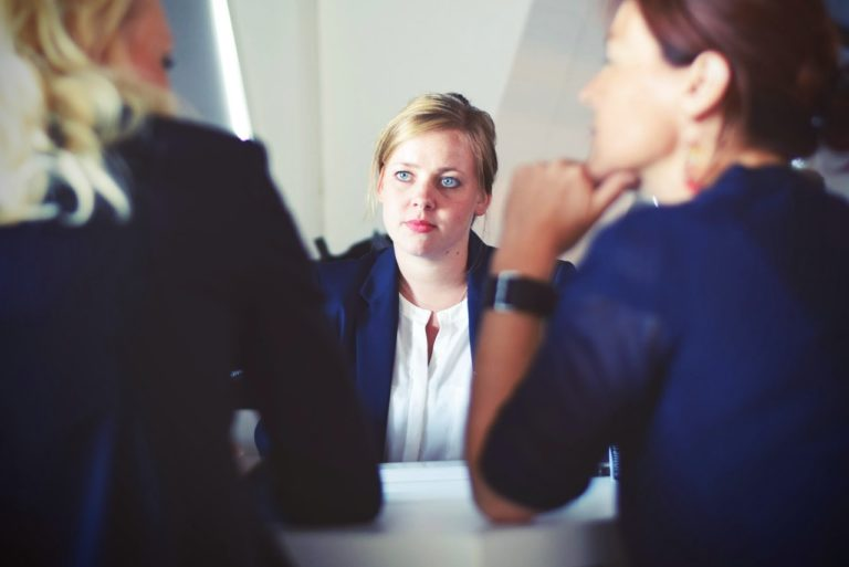 HR woman taking to 2 employees