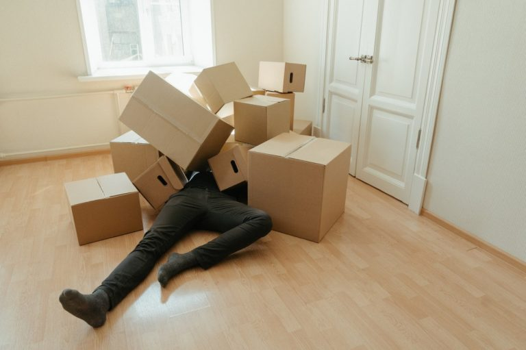 man buried in boxes