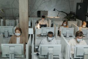 employees working wearing facemasks