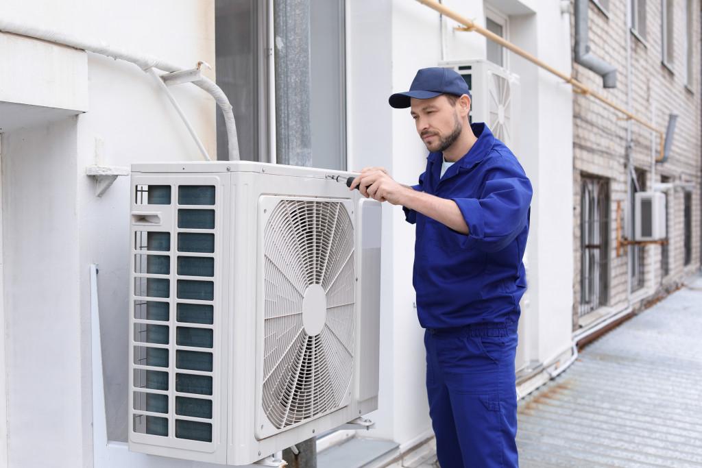 man installing air-conditioning unit