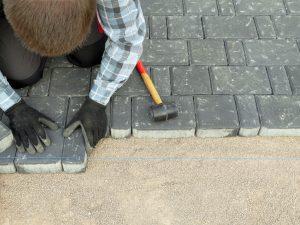person fixing flooring