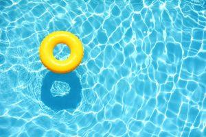 Yellow pool float in pool