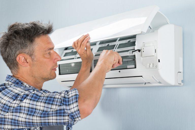 man repairing an air-conditioner
