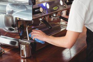 man cleaning the espresso machine